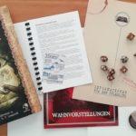 Mappe und Regelbuch mit Bezug zu Call of Cthulhu